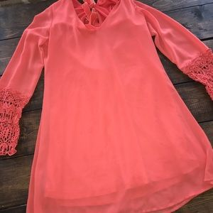 Coral dress with lace sleeves and bow back
